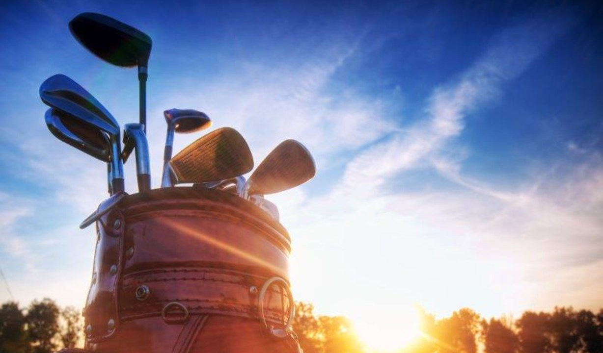 Thorpeness Golf Club, stock image clubs with sunset